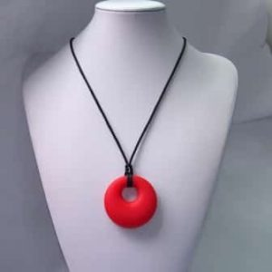 This stylish red happy hearted design features a 5cm x 5cm x 1.2cm donut shaped soft, silicone chew pendant for anxiety, chewy pendant for Autism, chew pendant for ADHD. A great educational tool to fill your sensory tank. The necklace cord is easily adjustable to accommodate your desired length and has a breakaway clasp for extra safety. Unisex sensory resource for people with special needs and/or chew their fingernails, chew their shirt collar. Chew on our healthy alternatives and order now www.ninjababies.com.au